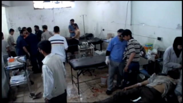 elections held / conflict continues syria damascus douma int gvs 11 year old boy saleh injured in mortar attack being treated in hospital treatment... - fake hospital stock videos & royalty-free footage