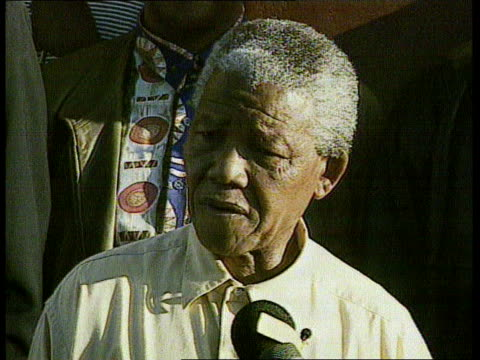 stockvideo's en b-roll-footage met kwazulu inanda cms nelson mandela putting vote into ballot box as people cheer pull out sot press gathered around cms nelson mandela speaking at pkf... - 1994