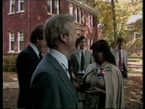 stockvideo's en b-roll-footage met us elections n carolina lexington ms governor james hunt campaigning in street accompanied by gary hart cms tv cameramen cms hunt chatting to... - gary w. hart