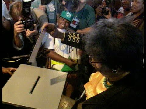 De Klerk casting vote Soweto TCMS Winnie Mandela placing her vote in ballot box TMS Archbishop Desmond Tutu placing vote in ballot box and cheering...