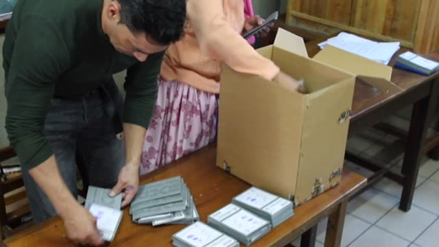 electoral delegates count votes at a polling station in la paz bolivia on october 12 2014 a rash of polls on the eve of th election put the leftist... - ボリビア点の映像素材/bロール