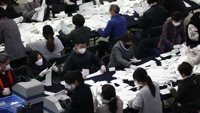 electoral officials count ballots for the parliamentaryelections at the olympic gymnastics arena in seoul south korea on wednesday april 15 2020 - seoul stock videos & royalty-free footage