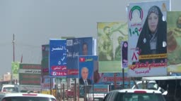 Electoral posters line the streets of Iraqi's Karbala the Shiite holy     Stock Footage Video