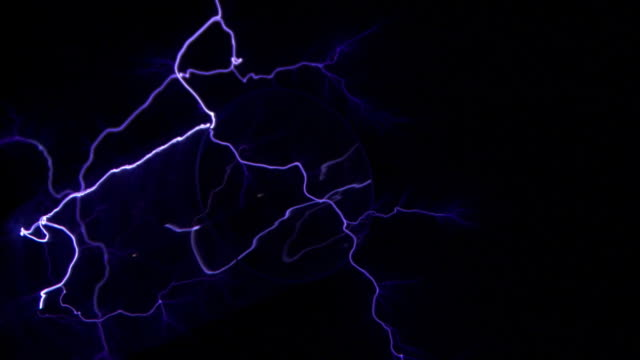 electric arcs through a clear tube - tesla coil stock videos and b-roll footage