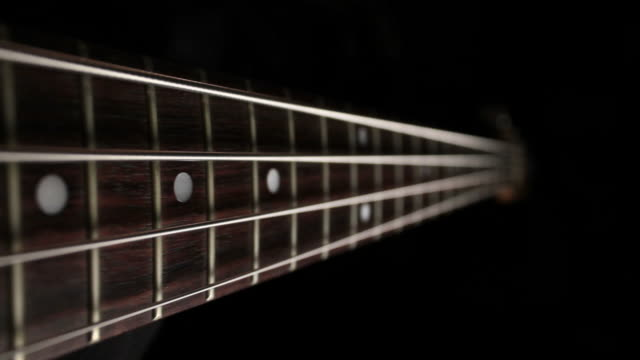 electric bass dolly shot, oblique - bass guitar stock videos & royalty-free footage