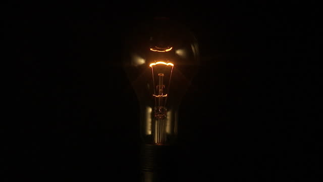 electric bulb with its light going out. - light bulb stock videos and b-roll footage