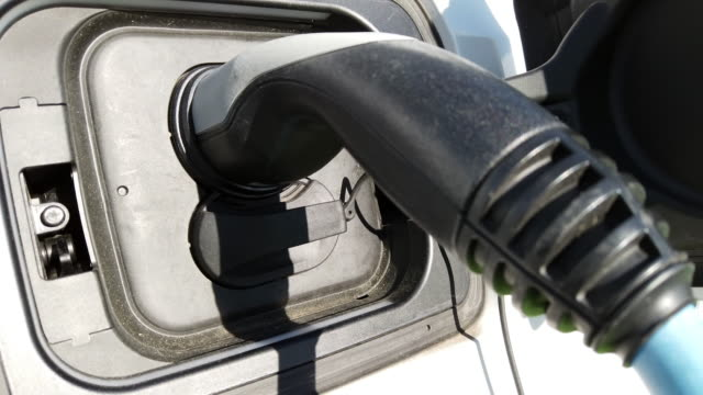 electric car at charging station - refuelling stock videos & royalty-free footage