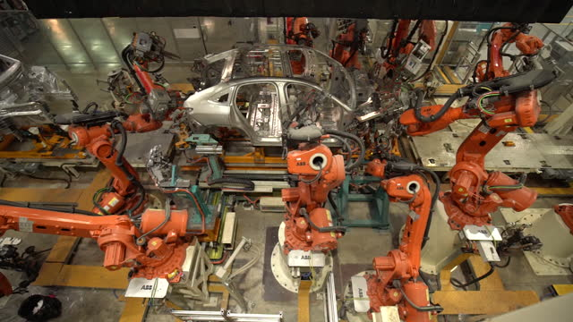 electric car being assembled by automated machinery in nio car plant in hefei, anhui province, china, on friday, december 4, 2020. nio is cementing... - production line stock videos & royalty-free footage