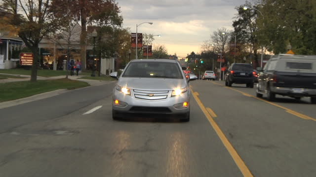 ws pov electric car being driven in city traffic / rochester, michigan, united states - electric vehicle stock videos & royalty-free footage