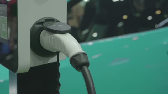 electric car charging a power at power station - gas station stock videos & royalty-free footage