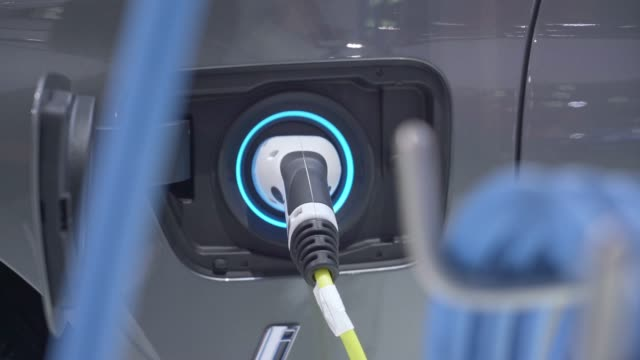 electric car charging fuel at power generation station - electricity stock videos & royalty-free footage
