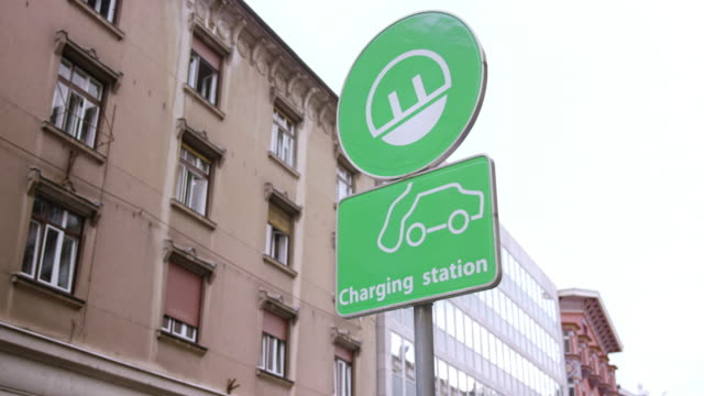 electric car charging station sign - energy efficient stock videos & royalty-free footage