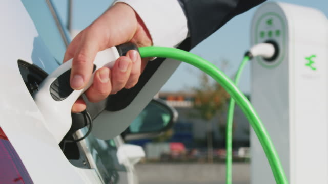 electric car charging - energy efficient stock videos & royalty-free footage