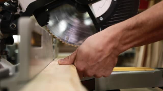 DS CU of electric circular saw cutting wood plank