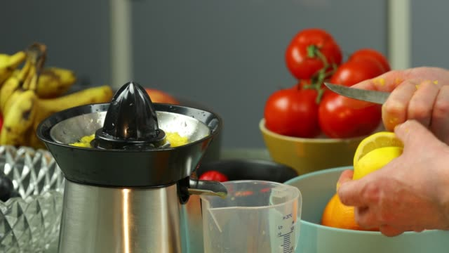 electric citrus juicer - electric juicer stock videos & royalty-free footage