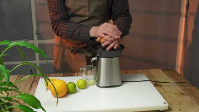 electric critrus juicer - electric juicer stock videos & royalty-free footage