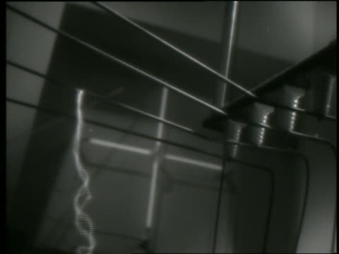 B/W electric currents flowing from wires in laboratory experiment