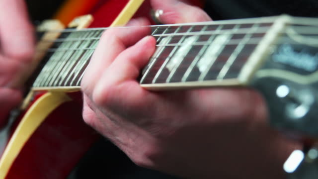 electric guitar solo close-up - geschwindigkeit stock videos & royalty-free footage