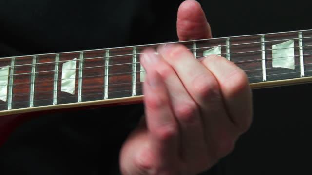 electric guitar solo close-up - künstlerische darbietungen stock videos & royalty-free footage