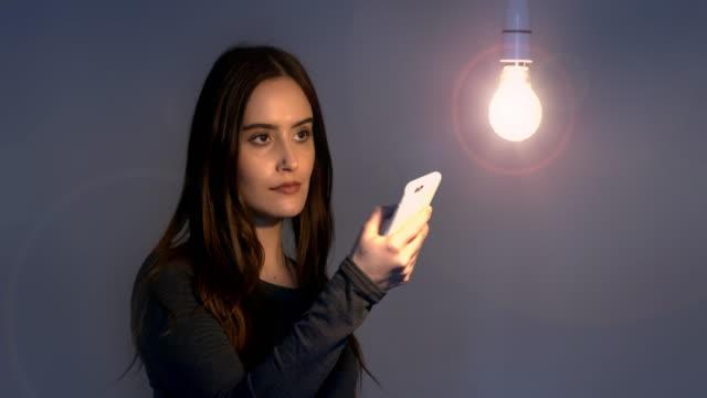 electric light on phone app. - accendere e spegnere video stock e b–roll