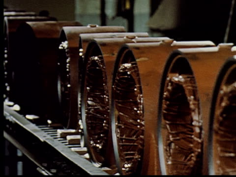 MS, HA, CU, COMPOSITE, PAN, Electric motors being assembled on factory conveyer belts, USA