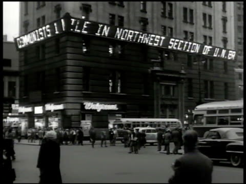 electric news bulletin scrolling korean communists conflict, 'walgreens' store, time square, new york. vs people standing on streets reading.... - new york city 1950s stock videos & royalty-free footage