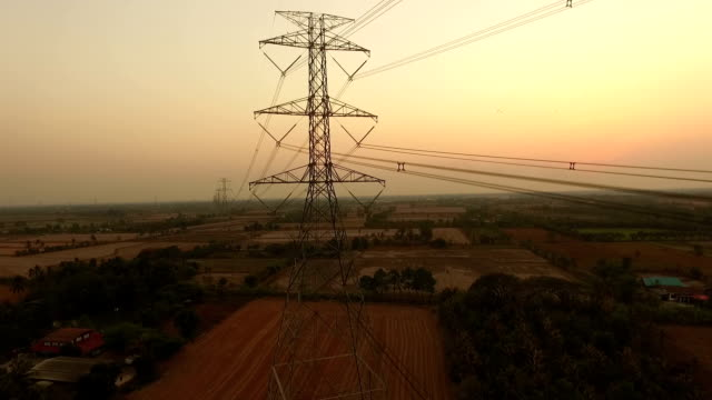 electric power station in the field on sunset - pole stock videos and b-roll footage