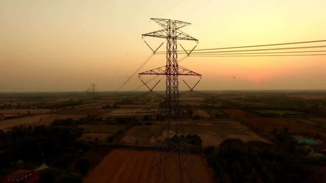 Electric power station in the field on sunset