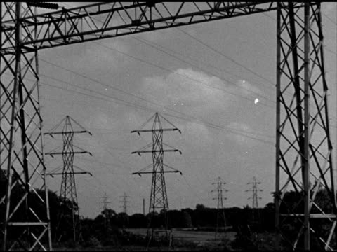 electric power transmission lines. power generator grid. various materials superimposed over power lines, 'plywood, aluminum, glass, plastics,... - stromnetz stock-videos und b-roll-filmmaterial