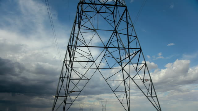 ms td t/l electric pylons against stormy sky / flagstaff, arizona, usa - flagstaff arizona video stock e b–roll
