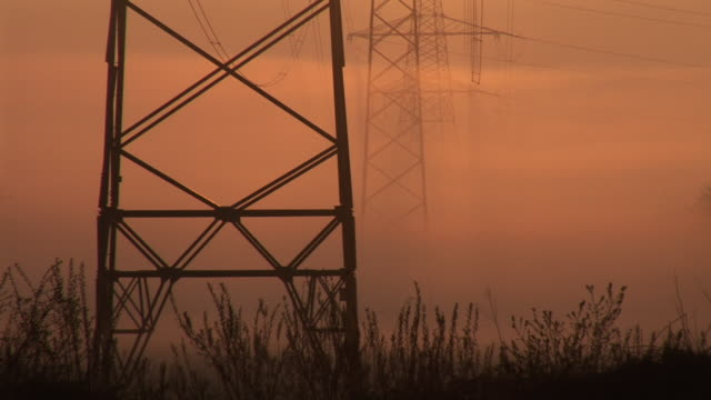 hd: electric pylons at sunrise - tower stock videos & royalty-free footage