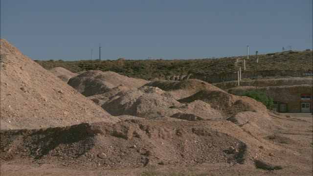 electric pylons cross the dry landscape near three crosses in coober pedy. - coober pedy stock videos & royalty-free footage
