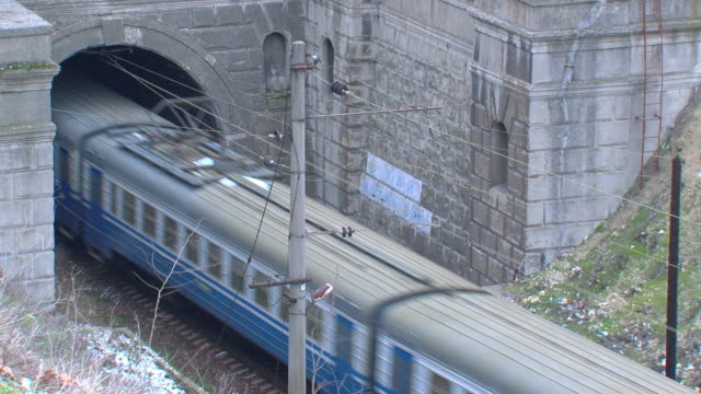 electric train enters a tunnel