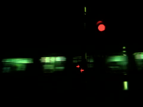 Electric train pass crossing, night time.
