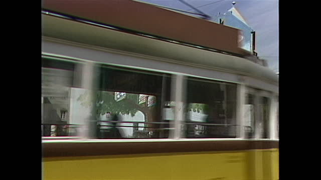 electric trains traveling the streets of budapest, hungary in the 1980s. - hungary stock videos & royalty-free footage