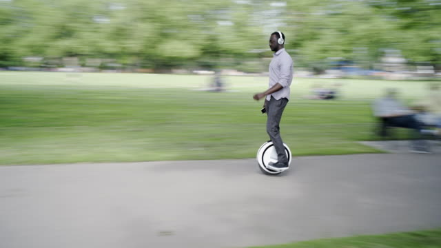 electric unicycle segway airwheel - one man only stock-videos und b-roll-filmmaterial