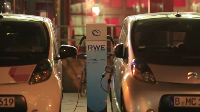 Electric vehicle charging plugs sit connected to an automobile charging station operated by RWE AG in Berlin Germany on Monday Dec 8 A Citroen...