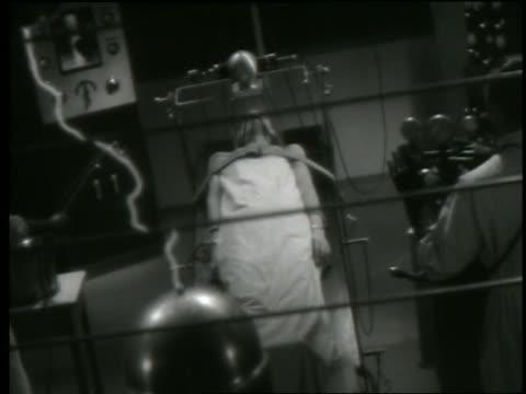 B/W electric waves flowing into dead body (Boris Karloff) in laboratory experiment