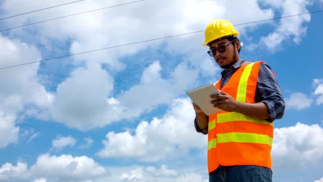 Electric worker using digital tablet