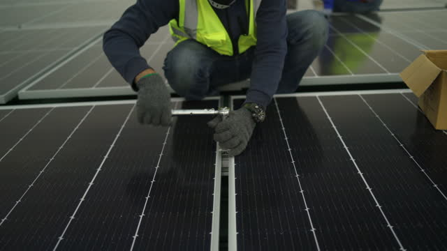 electrical engineer control plant system solar station. tecnical service worker asian man working at rooftop system salar panel. - ecosystem stock videos & royalty-free footage