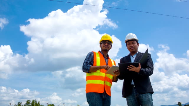 Electrical engineer inspects a project's progress with digital tablet