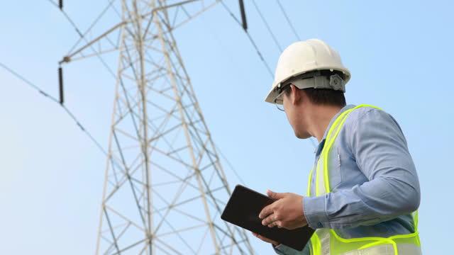 electrical engineer working on digital tablet - tower stock videos & royalty-free footage