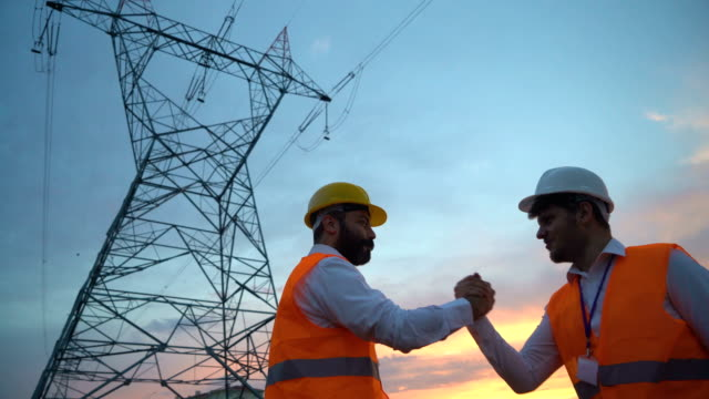 electrical engineers doing high five after successful work - partnership stock videos & royalty-free footage
