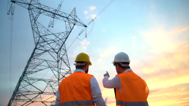 electrical engineers work on the project - high voltage sign stock videos & royalty-free footage