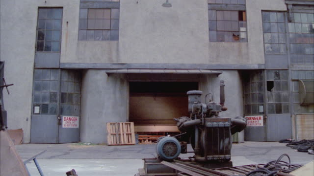 vidéos et rushes de ms zi electrical equipment in front of old warehouse - 1977