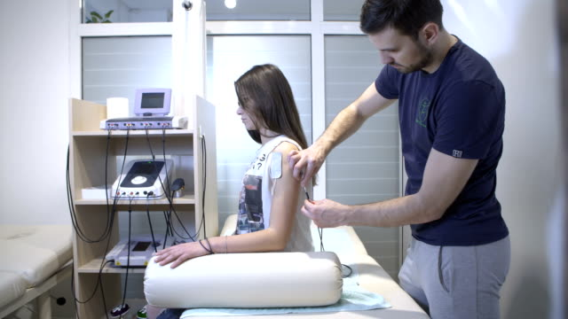 electrical muscle stimulation therapy - ligament stock videos and b-roll footage