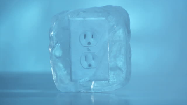 CU Electrical outlet frozen in ice block.