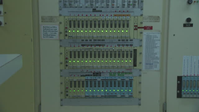 Electrical panel with green lights on ship'd bridge, Australia