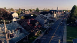 Electrical power lines and cables in Pennsylvanian town Bath at sunset. Appalachian mountains, Pennsylvania, USA. Aerial drone video with the forward camera motion.