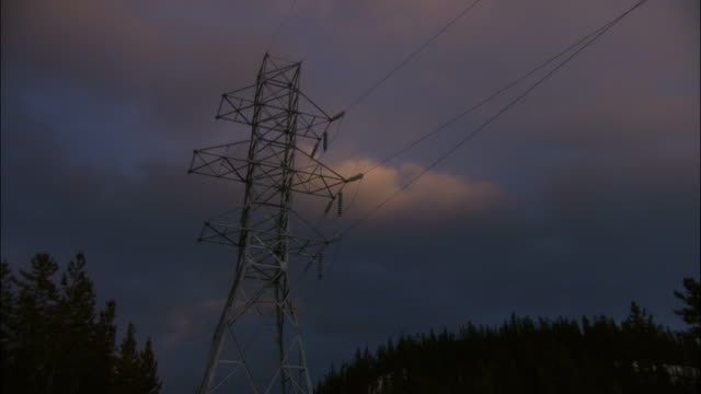 electrical power lines stretch to a transmission tower near a yukon hydroelectric plant. - whitehorse stock videos and b-roll footage
